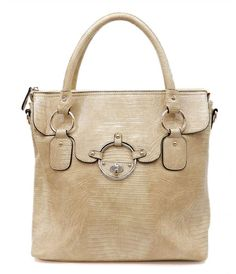 Carmen Tote purse | Chic with elegant classic lines, zip top closure,  Leather with gold tone hardware details. Lined inside with zipper pockets. Detachable shoulder strap. cute bag for fall.