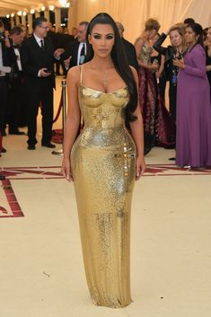 44d78714073 Kim Kardashian West in a gold chainmail Versace dress at the 2018 Met Gala  Versace Dress