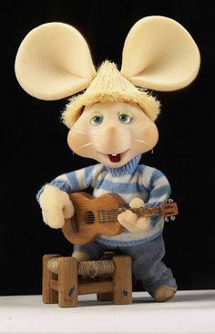 Topo Gigio guitarrista.