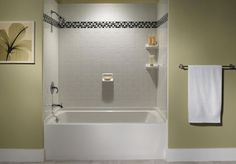 Limit Tile to the Surround    Mix function and style by limiting tile to the tub surround. Tile is an ideal choice for the surround because it's waterproof. Here, white tiles arranged in a vertical running brick bond (#255052) -- the traditional brick arrangement -- get a decorative lift from a strip of black-and-white mosaic glass tiles (#255044) just above eye level.