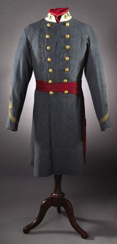 """Superb CSA Lieutenant Colonel of Staff officer's regulation frock coat and sash. Two 1 ½"""" five pointed stars are affixed to each side of the collar."""