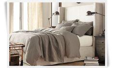 Gray bedding, linen headboard, off white walls, industrial sconces