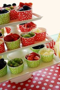 Great kids party food idea-individual serves of fruit, chips, whatever, to stop icky fingers in big bowls.