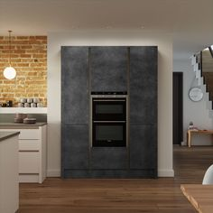 This shot features Cosdon handle-less in Gloss Savanna & Foundry doors in Charcoal to create the centre piece oven housing unit.   Cosdon handle-less is a beautiful, modern kitchen that offers complete personalisation and the ability to design the kitchen of your dreams.  The possibilities are endless when using the variety of doors available, so whatever look you are aiming for, use the Cosdon range as your palette.  When designing a modern kitchen, achieve the desired streamlined effect…