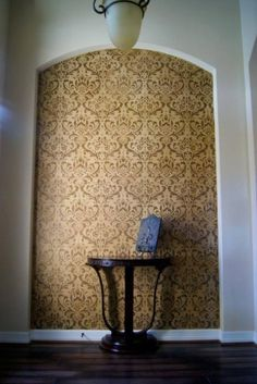 Stencil an accent wall using the Anna Damask pattern from Cutting Edge Stencils. http://www.cuttingedgestencils.com/damask-stencil.html  Austinologie, Faux Painting and Decorative Artistry located in Texas, crafted this gorgeous accent wall in a foyer.  Did they have you thinking it was wallpaper?  It's actually our Anna Damask stencil painted in rich golden brown tones.