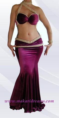http://www.makaridreams.com/ Extremely elegant belly dance costume for professional dancers. Beautiful italian smooth and dense velvet, cyclamen color, decorated with high quality faux pearl / glass beads trim. By Atelier Makari Dreams Belly Dance Costumes. Order online: http://www.makaridreams.com/