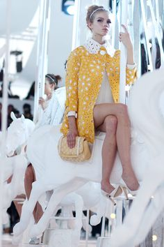 More of the Vuitton SS2012 show. This is my favorite yellow ever. And her makeup is completely perfect.