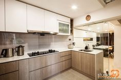 8 Ways to do a Semi-Open Kitchen in your HDB: Frameless glass walls are perhaps the most elegant way to block of unwanted grease and noise when you're cooking up a storm in the kitchen, while still allowing you to see what's going on in the rest of your home.