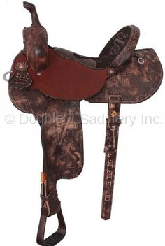 Pozzi Pro Barrel Racer by Double J Saddlery. A very unqiue creation. Chestnut leather is panel tooled in basketweave around brown filigree overlays on the rear skirt, front, and cantle. Seat jockey is roughout. Matching overlays are in the front of the choclate suede seat. Finished in our vintage finish, with copper berry conchos.