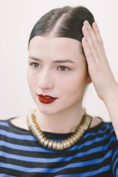 shade the outer corners of the lip precisely wiith slightly darker pencil (such as Nightmoth) and blend inwards using your brush. Finally, load a firm, larger 239 brush with a red Pigment. Press this onto the centre of the lips and blend. #refinery29