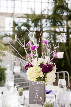 Ohio Botanical Lesbian Wedding | Flower centerpieces with crystals and tree branches | See more on equallywed.com