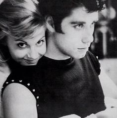 Grease behind the scenes. Her face!!! I love how Travolta is being all serious and Olivia is just ah!