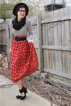 Long floral skirt, striped t, black heels, black scarf, black belt... Great look