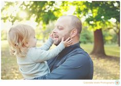 Happy and loving family together in Tower Grove Park | St. Louis Family Photography | Gabrielle Marie Photography