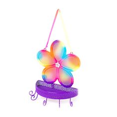 Let your jewelry collection shine on this bright and colorful flower hanging jewelry holder. The rainbow colored flower is covered in glitter and has a sparkly gem center. The basket is great for holding smaller items. Hang it on your wall for easy access to all your accessories.