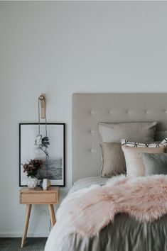 Soft and romantic bedroom with Scandinavian style bedside tables, upholstered bed and exposed bulb pendant lights on timber brackets. Gorgeous bedstyling