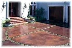 Front Door & Garage: Concrete stained drive with plantings help scale down the paved space. Acid Wash Concrete, Acid Stained Concrete Floors, Concrete Driveways, Concrete Patio, Concrete Staining, Outdoor Spaces, Outdoor Living, Outdoor Decor, Outdoor Ideas
