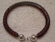 Black Viking Knit Bangle with Red and Orange by BraceletsByJoy