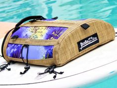 DeckBagZ, the first, the original, the only retro surf style deck bags for your paddleboard or kayak. Haole purple SUP deck bag. Made from wetsuit material and a woven vinyl mesh designed to look like