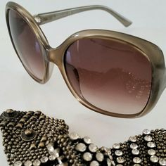 Valentino Designer Sunglasses Brown/gray gradient lenses. Silver bow design on sides. No scratches on lenses and frame. Purchased from another Website. No case. Frame is short for my wide face. Like new!  ☆☆PRICE IS FIRM☆☆ NO TRADES☆☆ Valentino Accessories Sunglasses