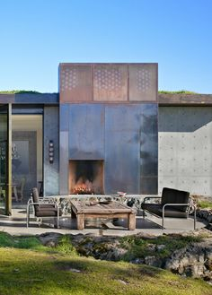 Pierre residence, Olson Kundig, shows a metal clad fireplace on an outdoor terrace