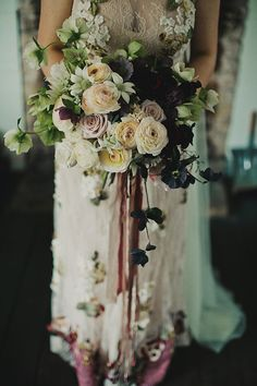 The combination of cream and dusty pink with darker purples and blacks and pale green and the long, trailing ribbon is so pretty.