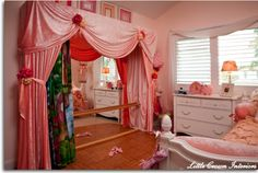 LOVE LOVE LOVE this idea for ballet room -  completely custom built stage is draped in pink crushed velvet with a set of hand-painted curtains that serve as a whimsical background for endless hours of make-believe in this ballerina princess bedroom! The dance stage features three movable backdrops, a laminate dance floor, ballerina bar, mirrored wall, and colored lights which move with the music.