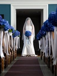 Line the aisle with blue hydrangeas & white ribbon