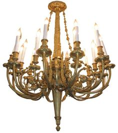 This exceptionally cast ormolu bronze chandelier, circa 1880s, features 18 electrified candles and is modeled after a design by Pierre Gouthiere (1740-1806), the noted French metalsmith who received numerous commissions from the court of King Louis XVI.