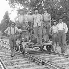A fantastic photograph of a section gang in Indiana. The foreman is the man to the right. He can be identified by the ever important watch hanging out of his pocket to keep tabs on when the next train was to arrive. Not watching the time would lead to certain death for the crew. Also, he probably was paid better allowing him to eat better than his crew. He appears to have a little more meat on his bones than the rest.