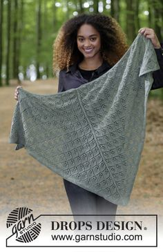 Shawl with lace pattern, worked top down. Piece is knitted in DROPS BabyAlpaca Silk. Free pattern by DROPS Design.