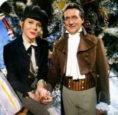"Diana Rigg and Patrick Macnee in costume as a lip-sticked Oliver Twist and Sydney Carton from ""Too Many Christmas Trees."""