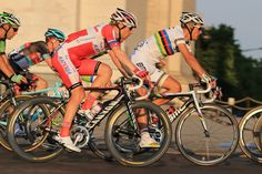 Pavel Brutt of Katusha and Philipe Gilbert of BMC Racing Team in action during the twenty first and final stage of the 2013 Tour de France, a processional 133.5KM road stage ending in an evening race around the Champs-Elysees, on July 21, 2013 in Paris, France.