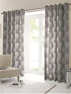 Attractive Silvestry Printed Eyelet Curtains