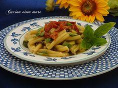 La pasta risottata profuma d'estate e racchiude tutti i gusti e i sapori del mediterraneo: un primo piatto particolarmente ricco, aromatico e goloso!