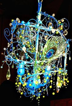 blue wire sculpture peacock light. Beautiful, I wonder how it looks with the light on