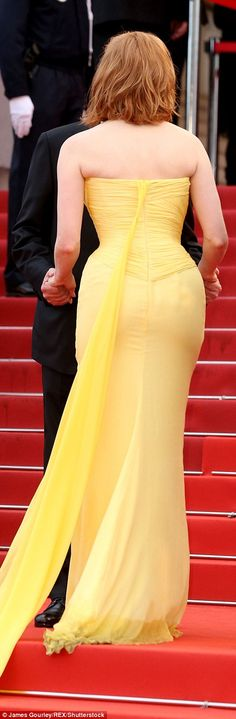 Turning heads: Jessica Chastain stood out in a bright yellow number as she took her turn i...