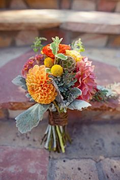 Love the idea of having all different colors of flowers coupled with a shade of bue