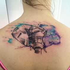 Watercolor elephant tattoo on back by Sandro Stagnitta
