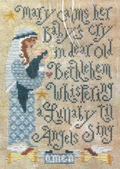 Silver Creek Samplers Mary's Lullaby - Cross Stitch Pattern. Mary calms her baby's cry in dear old Bethlehem whispering lullaby til angels sing. Model stitched