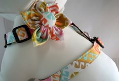 Want to make your dog look snazzy for your wedding but dont quite want to go the clothes route? These snazzy harnesses with flower bows or bow ties are the perfect answer.  Dog Harness with Flower or Bow Tie Set  by LearnedStitchworks, $29.00