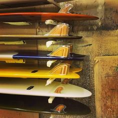 A new batch of Almond boards with Gully-crafted fins, being glassed by Waterman's
