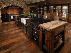 Rustic kitchen.  Love all the different wood tones, and the upcycled wood on the chopping block island!!