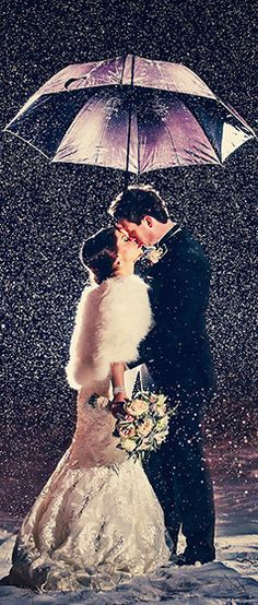 Incredibly romantic winter wedding moment - bride and groom under a snowy umbrella   From Just Married Photography in Edmonton/Alberta - view full profile in link