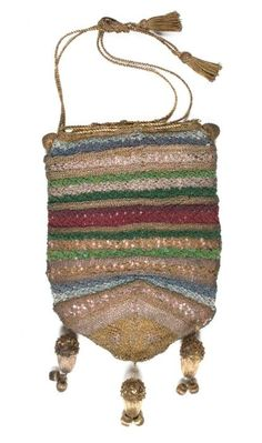 The acorns hanging at the bottom of this 1820s bag are thought to represent the notion to 'save and prosper'. Initially purses were not only used to put spending money in, they were used for saving money too. Circa 1820.