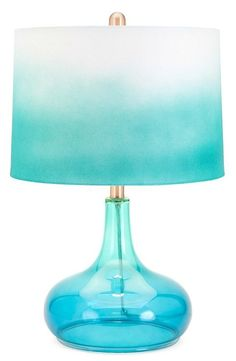 The ocean inspired green blue color of the glass body and the trendy ombre fabric shade give our Caden Table Lamp a look that instantly brightens a room.