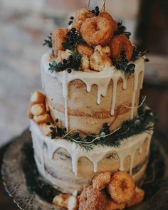 Oh my!  Naked cake topped with cinnamon mini doughnuts.. This one looks a bit of a mess but I love the idea!