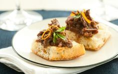 Cranberry-Orange Braised Beef on Ciabatta // Entertaining? Holiday party? This is a great appetizer to serve.