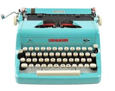 Vintage turquoise type writer from 1956