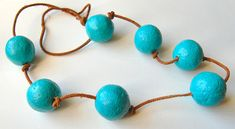 This is probably the cheapest craft ever. What you'll need to make your own paper jewelry: Newspaper, get some of those free ones for extra cheapness. Craft paint or whatever type of p… Paper Jewelry, Paper Beads, Beaded Jewelry, Textile Jewelry, Bead Crafts, Jewelry Crafts, Diy Paper, Paper Crafts, Do It Yourself Jewelry
